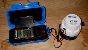 My first generation electric kayak pump. The grey metal nozzle on the left side of the battery case is a pneumatic switch, activated through a hose by an air button.