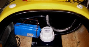 The electric bilge pump and battery case in place in the kayak