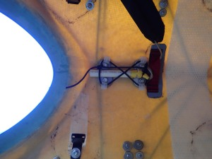 A underdeck view of the magnetic reed switch in place
