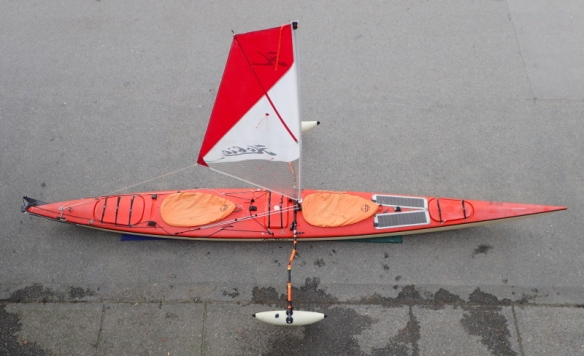 double kayak fitted with Hobie Mirage sail and Sidekick amas