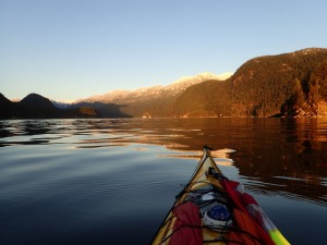Looking over the kayak's bow up a calm inlet