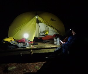 A tent and camper at night