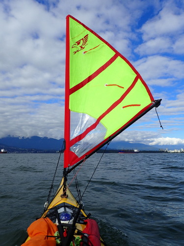 a sail on the front of a sea kayak