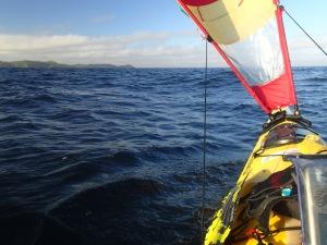 paddler's eye view of a sea kayak sailing