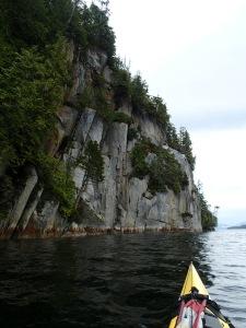 a kayaker's POV of seaside cliffs
