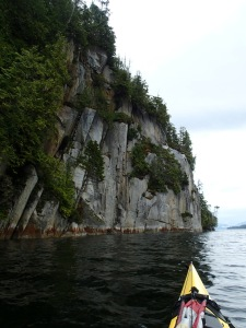 a kayaker's POV of seaside cliffs