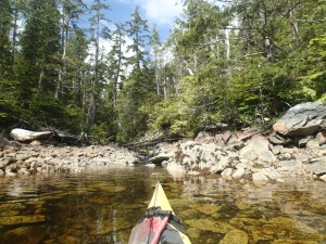 View of a creek over the bow of sea kayak