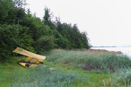 An island campsite with tent, tarp and sea kayak