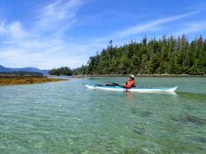 a sea kayaker on calm water