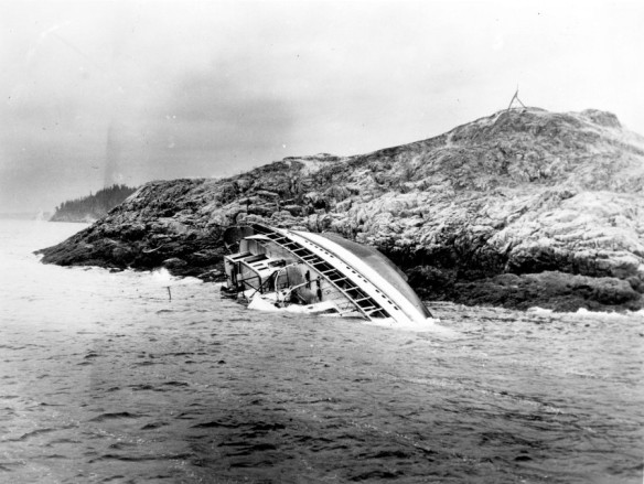 A shipwreck on a rocky islet