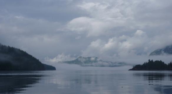 a sea channel in low-lying fog