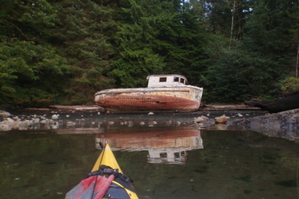 the wreck of a fishing boat on shore
