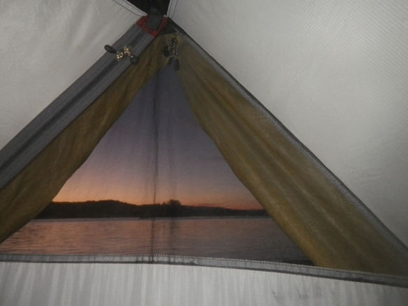 sunrise seen through a tent window
