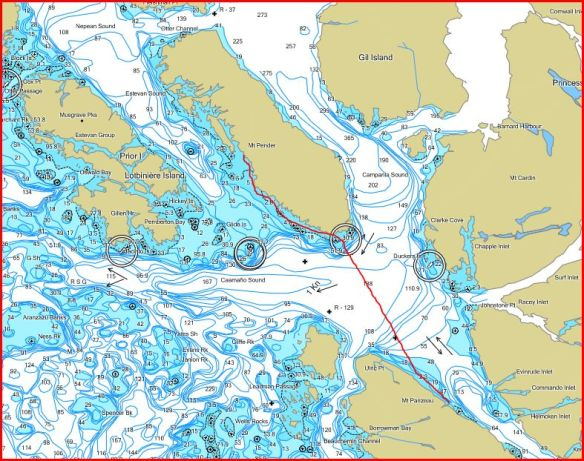 a marine chart with a kayak route traced in red