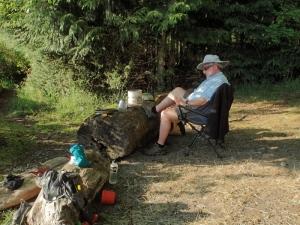 a camper lounges in a beach chair