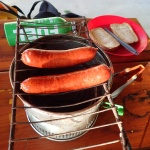 Smokie sausages on a stove top grill
