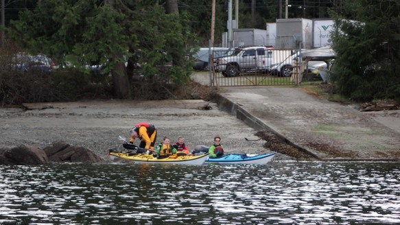 Sea kayakers launch at the beach by the Swartz Bay public dock