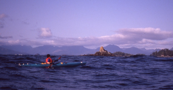 a sea kayak off Sail Rock, in the Broken Group islands, British Columbia
