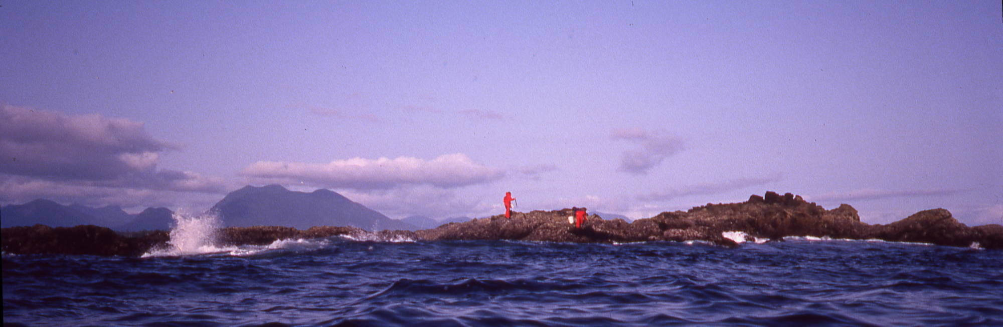 two men in red floater suits standing on Verbeke Reef in the Broken Islands group, British Columbia