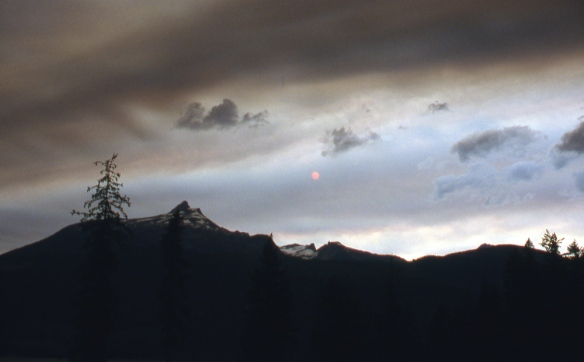 a storm-darkened sky in the mountains above Slocan Lake, BC