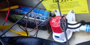 the electric pump and battery box in place behind the sea kayak seat